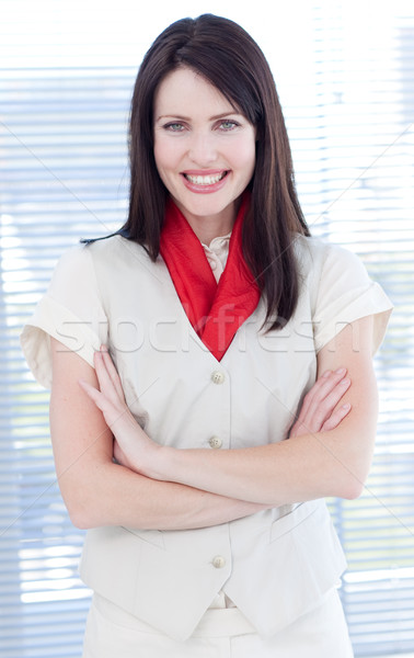 Atraente empresária dobrado brasão sorridente câmera Foto stock © wavebreak_media