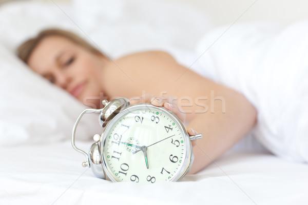 Young woman holding an alarm clock Stock photo © wavebreak_media