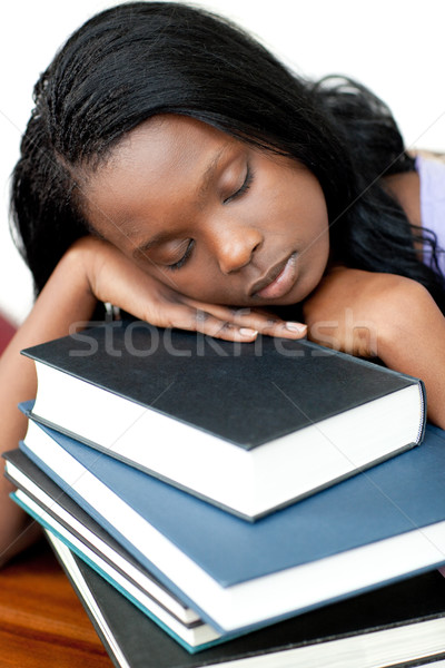 Sleeping student leaning on a stack of books Stock photo © wavebreak_media