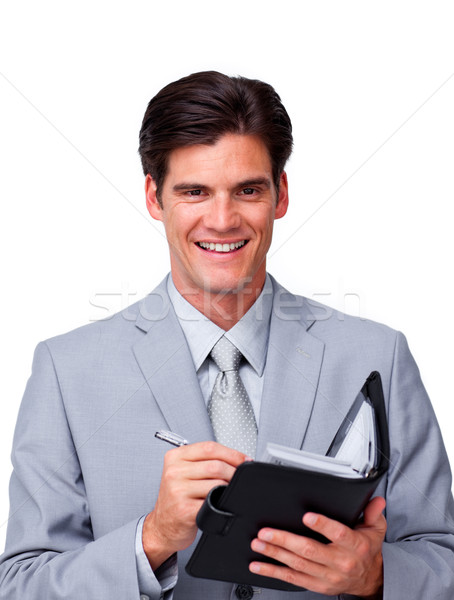 Charismatic businessman holding an agenda  Stock photo © wavebreak_media