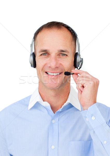 Volwassen zakenman hoofdtelefoon witte business glimlach Stockfoto © wavebreak_media