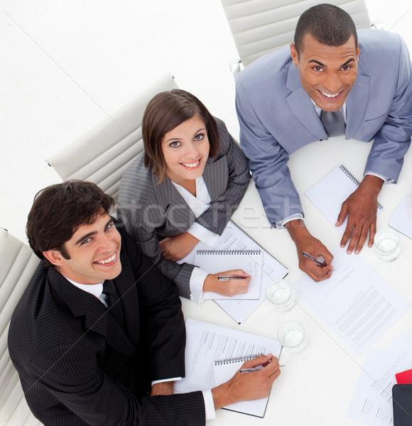 Tres colegas sonriendo cámara reunión Foto stock © wavebreak_media