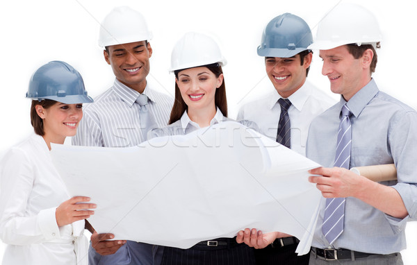 Multi-ethnic group of architects wearing hardhats Stock photo © wavebreak_media