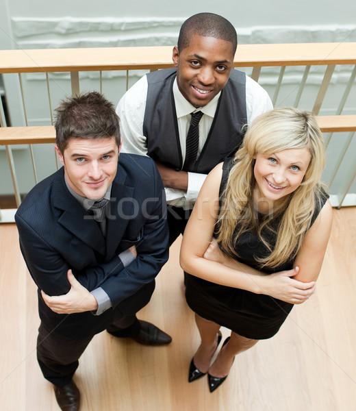 Wysoki widoku ludzi biznesu fałdowy broni international business Zdjęcia stock © wavebreak_media