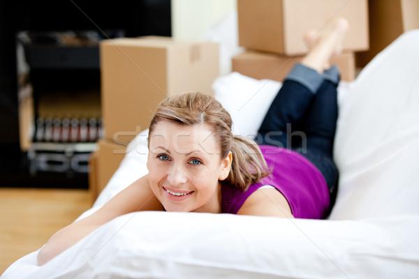 Cheerful woman having a break between boxes Stock photo © wavebreak_media