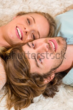 Laughing handsome woman having fun with a man in bed  Stock photo © wavebreak_media
