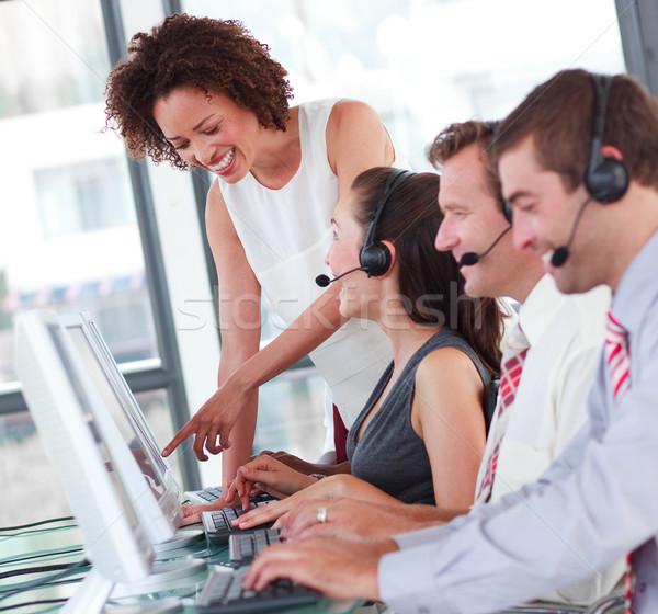 Beautiful female manager with her sale representative team at work Stock photo © wavebreak_media