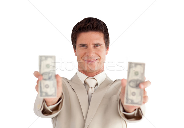 Rich Businessman with Dollars on his hands against a white background Stock photo © wavebreak_media