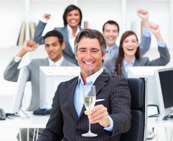 торжествующий менеджера команда питьевой шампанского служба Сток-фото © wavebreak_media