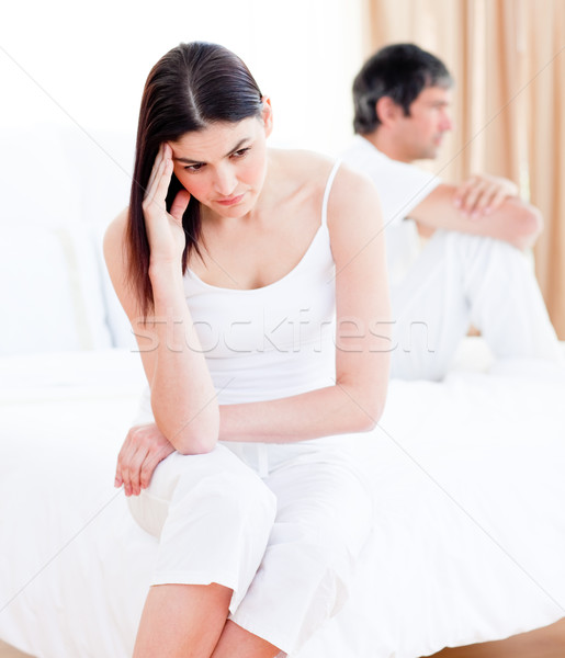 Upset couple having an argument sitting on bed at home Stock photo © wavebreak_media