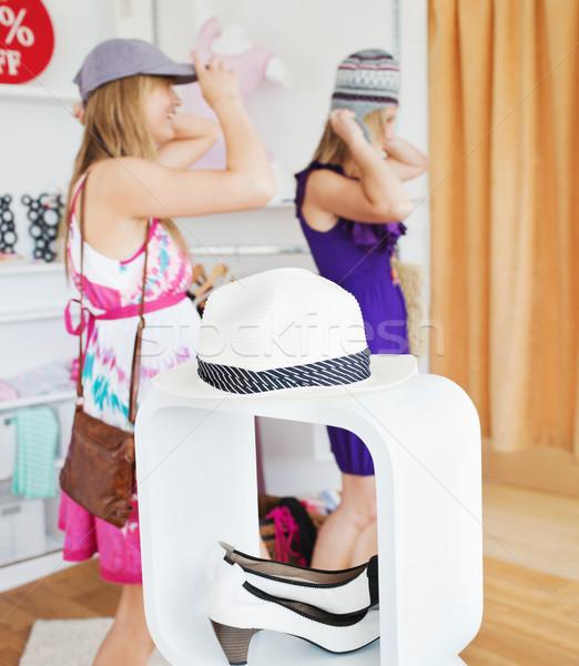 Happy women choosing clothes together in a shop  Stock photo © wavebreak_media