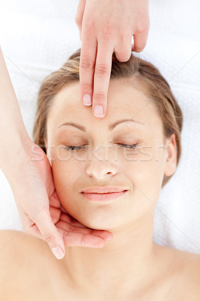 Positive young woman having a head massage in a health spa Stock photo © wavebreak_media