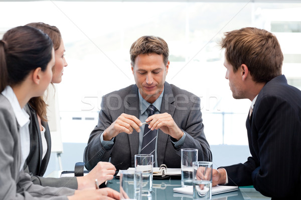 Serious manager at a table with his team during a meeting at the office Stock photo © wavebreak_media