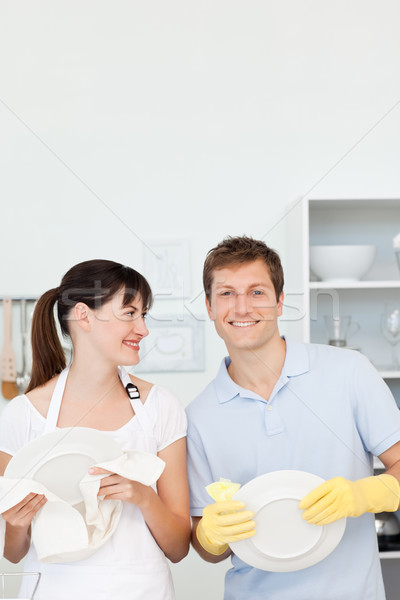 Lovers washing dishes together in their kitchen Stock photo © wavebreak_media