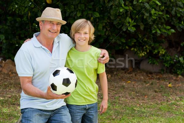 Grand-père petit-fils regarder caméra football football Photo stock © wavebreak_media