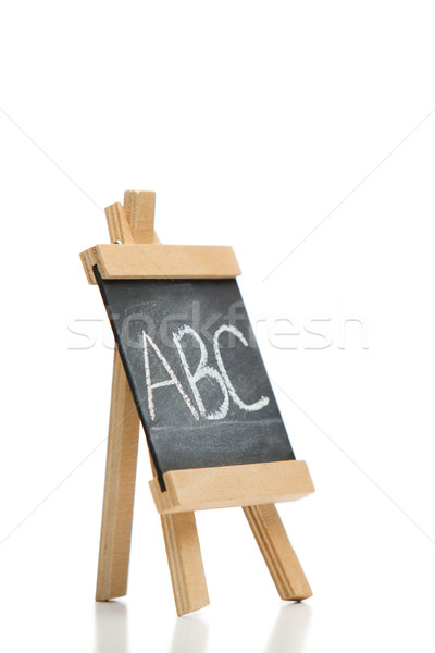 Angled chalkboard with the letters abc written on it isolated against a white background Stock photo © wavebreak_media