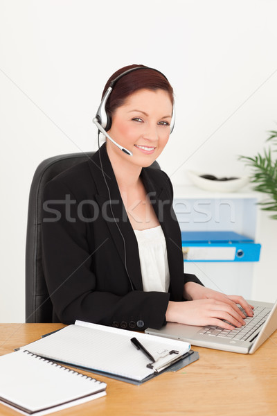 Young gorgeous red-haired woman in suit typing on her laptop Stock photo © wavebreak_media