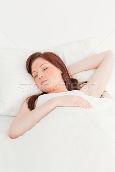 Primo piano di bell'aspetto femminile dormire letto donna Foto d'archivio © wavebreak_media