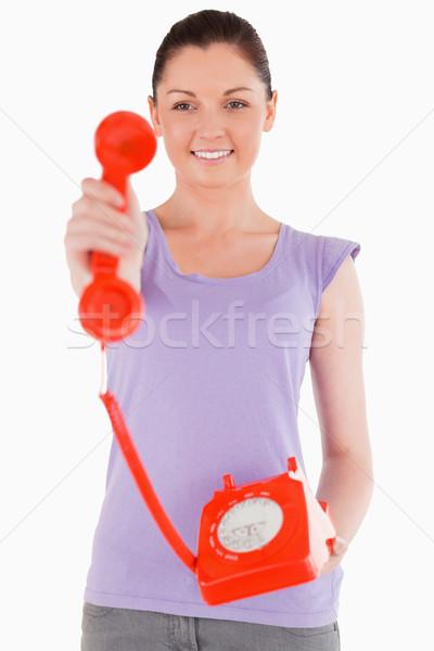 Charmant vrouw Rood telefoon permanente Stockfoto © wavebreak_media