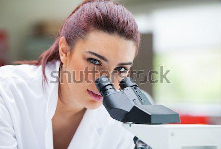 Bilim adamı bakıyor mikroskop laboratuvar kadın Stok fotoğraf © wavebreak_media