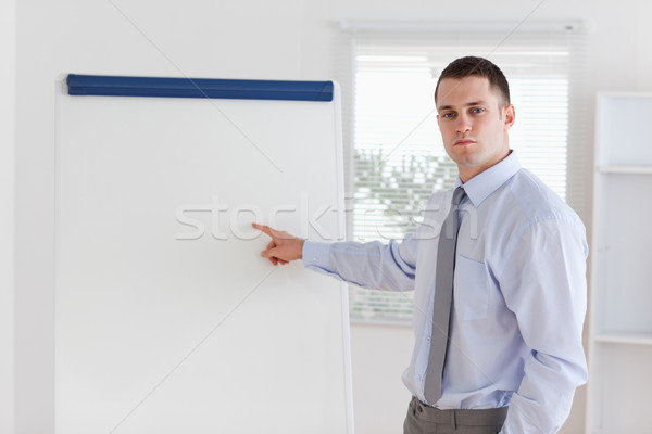 Young businessman explaining the flip chart Stock photo © wavebreak_media