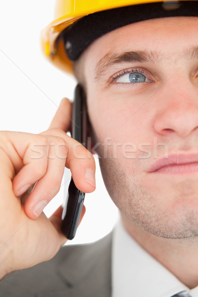 Close up of a young architect making a phone call against a white background Stock photo © wavebreak_media