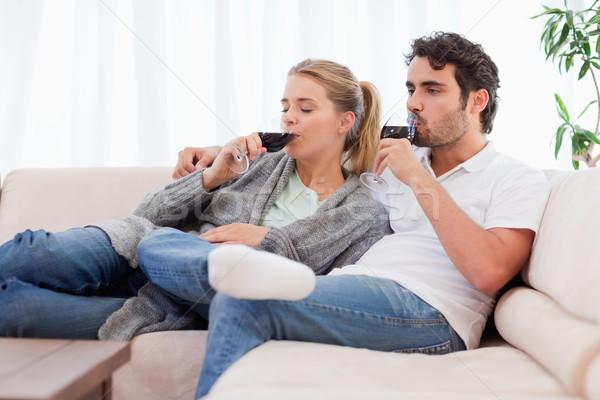 Casal vinho sala de estar feliz casa Foto stock © wavebreak_media