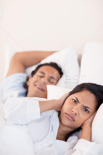 Young man keeping his girlfriend awake with snoring Stock photo © wavebreak_media