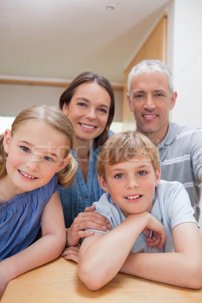 портрет Cute семьи позируют кухне глядя Сток-фото © wavebreak_media