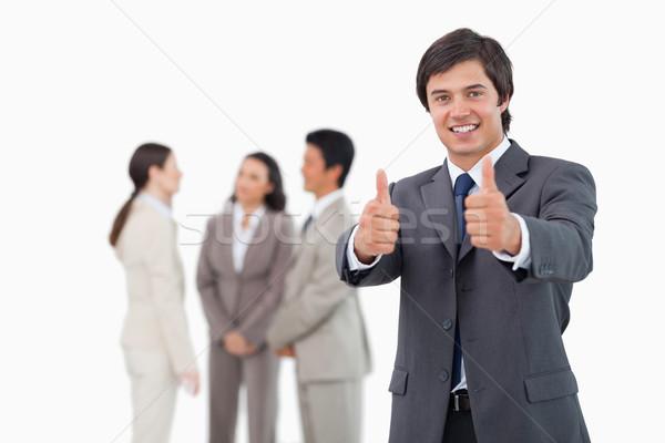 Vendedor aprovação equipe atrás branco sorrir Foto stock © wavebreak_media