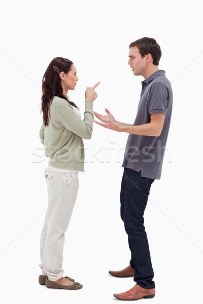 Woman scolding man against white background Stock photo © wavebreak_media