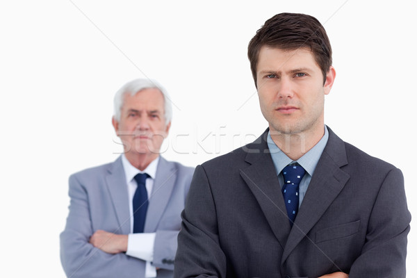Close up of serious businessman with his mentor behind him against a white background Stock photo © wavebreak_media