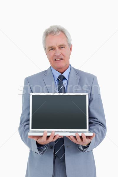Mature tradesman presenting screen of his laptop against a white background Stock photo © wavebreak_media