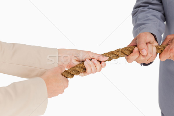 Business people pulling the rope against white background Stock photo © wavebreak_media