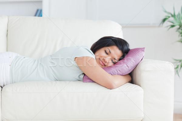 Mulher adormecido sofá travesseiro sala de estar janela Foto stock © wavebreak_media
