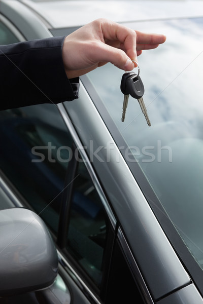 Someone holding car keys by his fingertips outdoors Stock photo © wavebreak_media