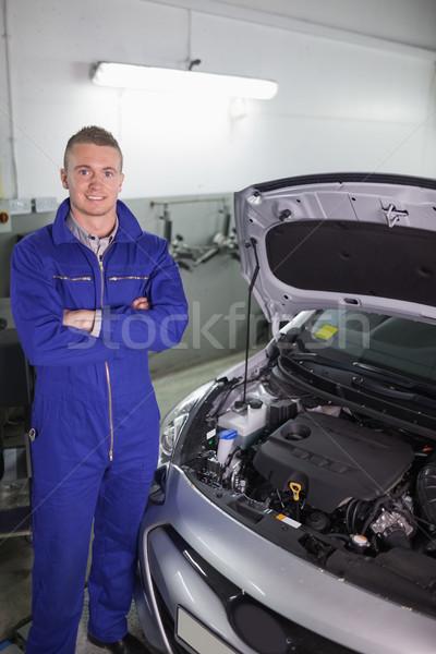 Lächelnd Mechaniker stehen Garage Lächeln glücklich Stock foto © wavebreak_media