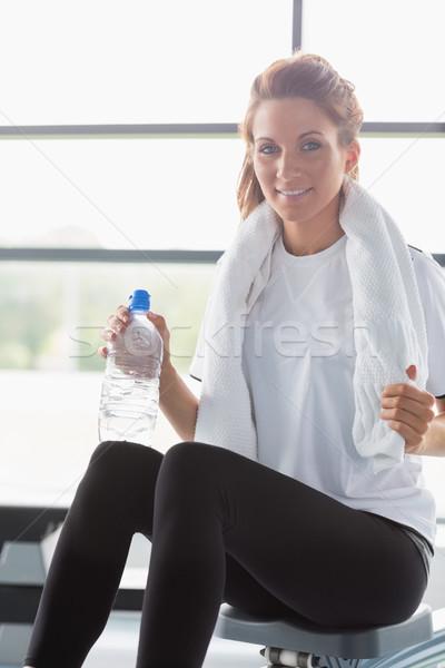 женщину сидят машина питьевая вода спортзал Сток-фото © wavebreak_media