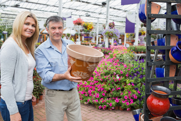 Couple choosing ceramic flower pot in garden center Stock photo © wavebreak_media