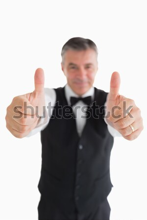 Cheerful man in suit with thumbs up Stock photo © wavebreak_media