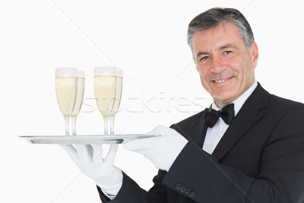 Mosolyog pincér tart ezüst tálca szemüveg Stock fotó © wavebreak_media