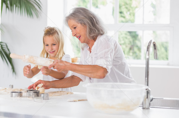 Grandmother and granddaughter using a rolling pin Stock photo © wavebreak_media
