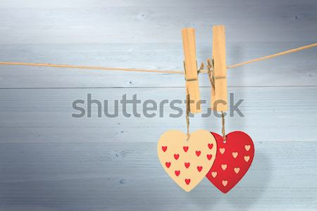 Two heart decorations hanging from pegs on a line Stock photo © wavebreak_media