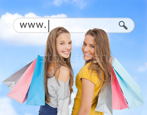 Smiling girls with their shopping bags under address bar Stock photo © wavebreak_media