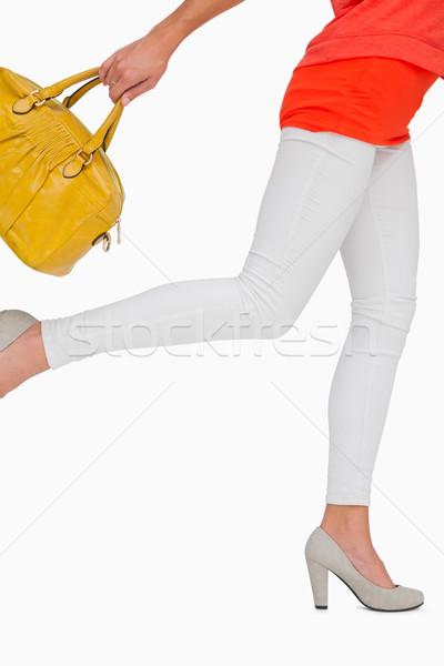 Femme jaune sac blanche mode Photo stock © wavebreak_media