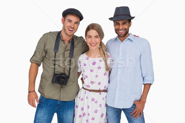 Attractive friends with a camera embracing Stock photo © wavebreak_media