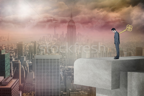 Composite image of wound up businessman with hands in pockets Stock photo © wavebreak_media