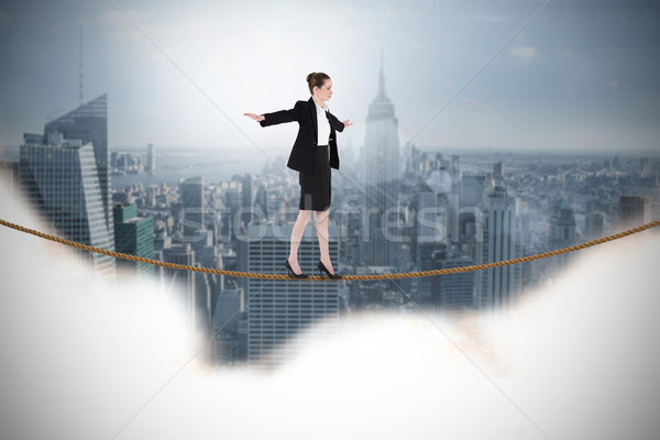 Composite image of businesswoman performing a balancing act Stock photo © wavebreak_media