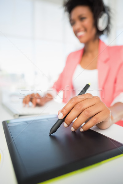Casual female photo editor using graphics tablet Stock photo © wavebreak_media