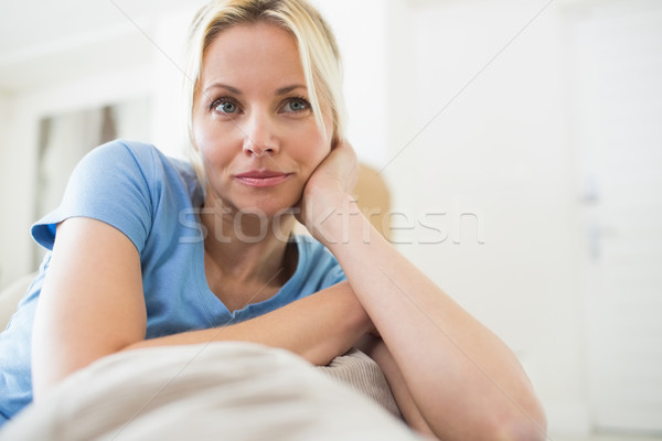Thoughtful young woman sitting in living room Stock photo © wavebreak_media